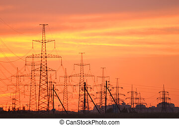 Electric power transmission lines at sunset - The photo of...