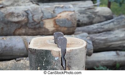 Lumber industry - Chopping wood with wedge and hammer
