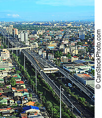 Metro Manila - Aerial view on slum and highway in Metro...