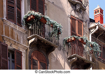 Balconies at old town houses in Verona, Veneto, Italy