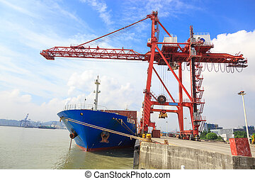 Moored container ship in a harbor - Frontal view of a...