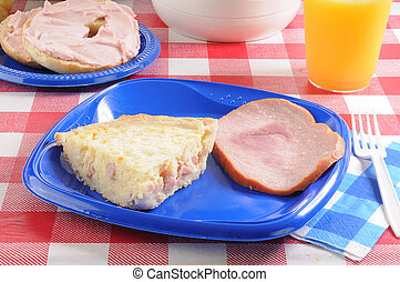 Quiche Lorraine with a bagel and ham
