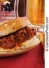 Closeup o a sloppy joe and mug of beer - Close up of a...