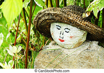 Painted woman face on rock - Original homemade garden...