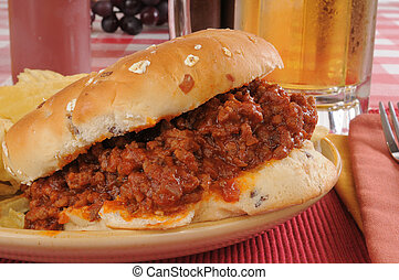 Sloppy joe burger - Closeup of a sloppy joe with a mug of...