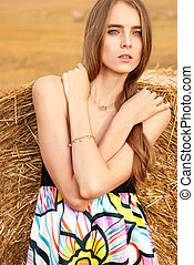 girl standing near haystack - beautiful girl standing near...