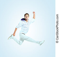 Jumping young man Isolated over blue background