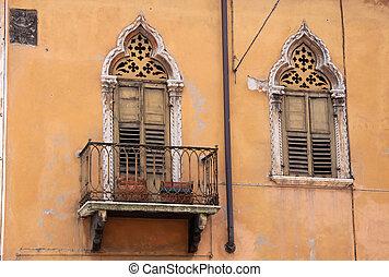 Narrow balcony in the old town of Verona, Veneto, Italy