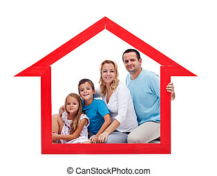 Family and home concept with young adults and two kids in...