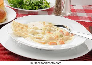 chicken dumpling soup - A bowl of thick chicken and dumpling...