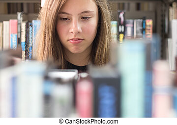 Girl in Library - Cute teenage girl in the library viewed...