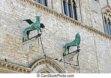 bronze statues of a winged Griffin and a lion in Perugia -...