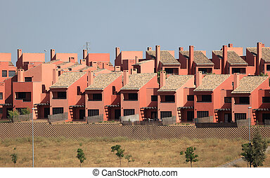 Row of modern new townhouses in Spain
