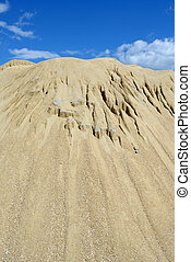 Sand mound  - Brown sand mound and against sky
