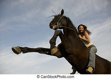 happy girl and rearing stallion