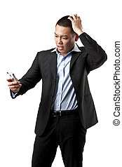 Angry young man shouting using mobile - portrait of angry...