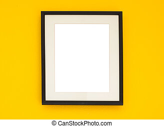 Wooden frame on the yellow wall
