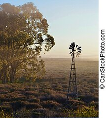 Windmill water pump - Landscape with Windmill water pump at...
