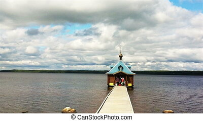 Chapel on water in Vazheozersky monastery, Karelia, Russia