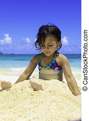 little Polynesian girl at the beach