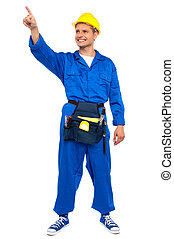 Construction worker pointing at copy space area