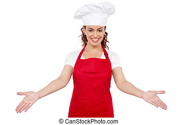 Smiling woman chef welcoming you to her workplace Isolated...