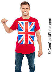 Cool guy with idea of UK flag on t-shirt Holding flag and...