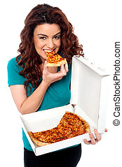 Young cheerful girl enjoying pizza alone All on white...