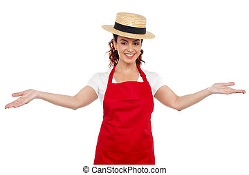 Pretty chef welcoming you with her arms stretched isolated...