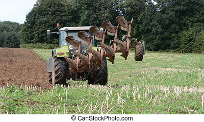 tractor plowing on autumn tillage - tractor in farm plowing...