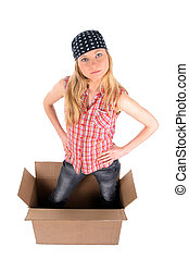 Girl in a cardboard box, looking up
