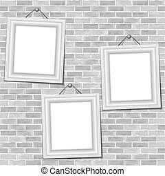 Frames hanging on a brick wall