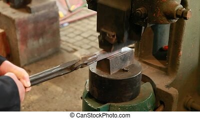 Industry - Hot iron lingot on a press machine
