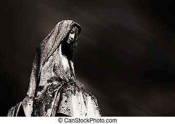 virgin mary and dark sky