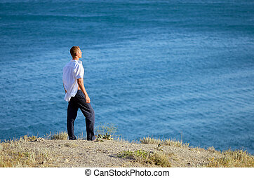 Young man looks at the sea