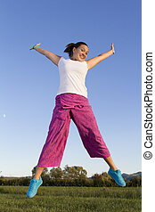 Cute jumpin girl in fisherman pants
