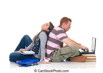 Teen students working on laptop - trendy teenager students...