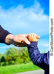 trust family hands of child son