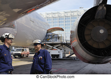airplane mechanics and jet engines - two airplane mechanics...