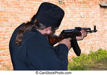 Man with the Kalashnikov gun - Monk with Kalashnikov machine...