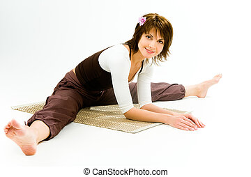 Relaxed girl - Photo of a sporty girl sitting on a rug with...