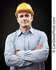 Construction engineer - Young construction worker in hard...