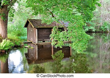 Boat-house - boat-house below the tree