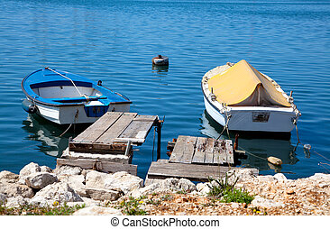 two boats - A small fishing two boats in blue sea (ocean or...