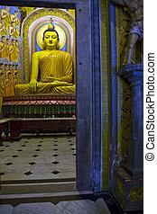 Buddha at Gangaramaya Vihara Buddhist Temple in Colombo, Sri...