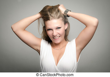 Pretty girl pulling her hair in frustration - Funny portrait...