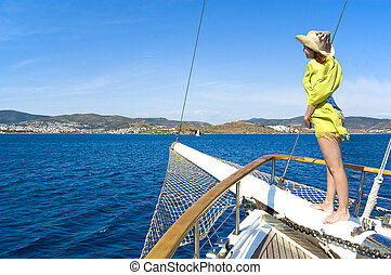 Woman on bowsprit - yacht is heading to the Mediterranean...
