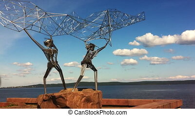 Fishermen monument on a quay in Petrozavodsk, Russia