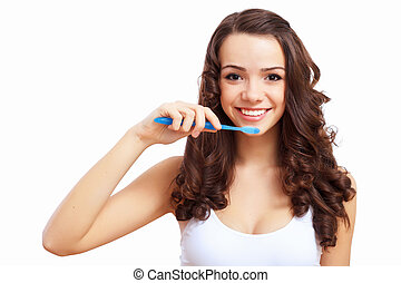 Young woman at home brushing teeth