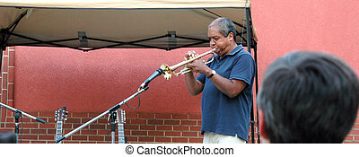 Trumpet player - African american male trumpet player...